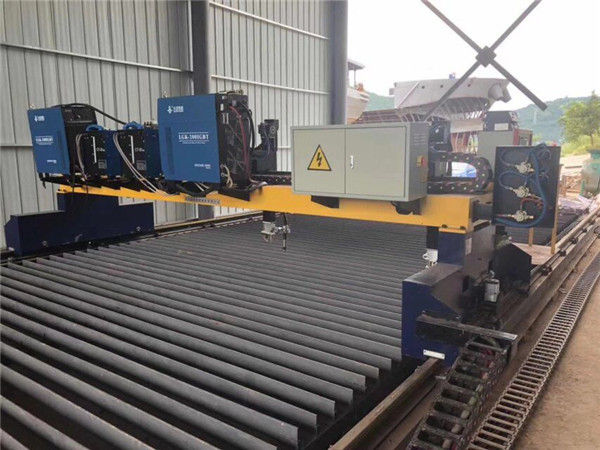 Máquina de corte por plasma CNC de pórtico de doble accionamiento para cortar la línea de producción de vigas en H de acero sólido